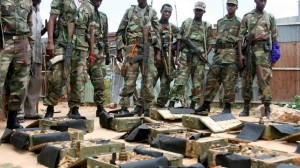 Ethiopian soldiers stand guard near boxes of weapons found hidden under a building in Mogadishu May 9, 2007. A large cache of weapons, believed to have been hidden by the Islamists, were discovered in Mogadishu by the Ethiopian forces and their Somali allies on Tuesday. REUTERS/Shabelle Media (SOMALIA)